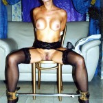 Elizabeth tied to a chair