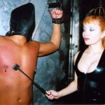 Aiden Starr whips her slave