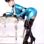 Julie Simone in a latex uniform